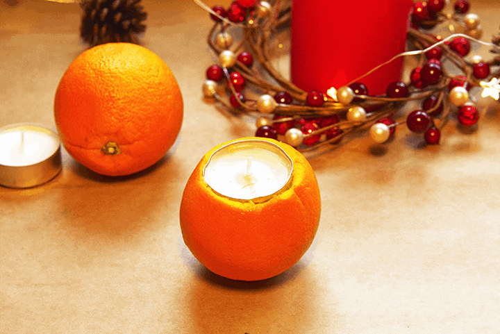 process step for orange and clove pomander candle holder
