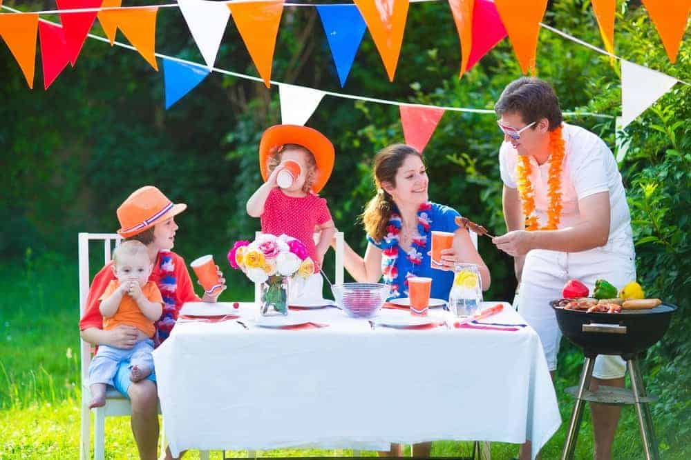 decorated backyard with a family of 5 celebrating at home during quarantine