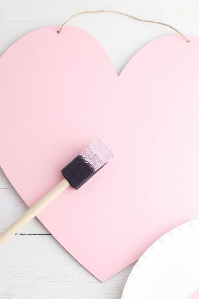 painting wooden heart pink for valentine's DIY decor craft