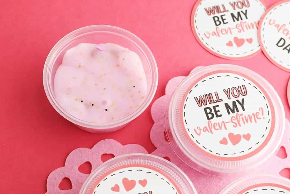 slime valentine with printable gift tags in takeout containers