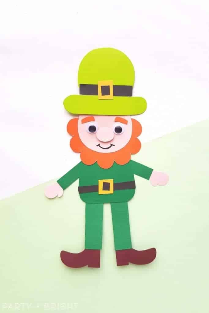 cute leprechaun paper puppet made from printable template on a white and green background