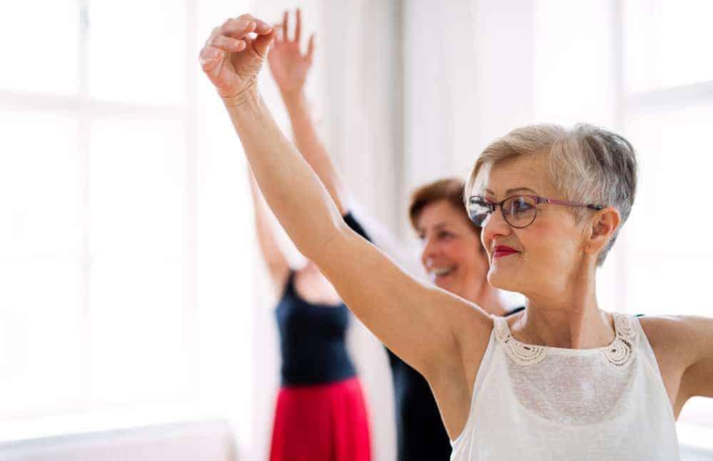 senior females taking ballet class
