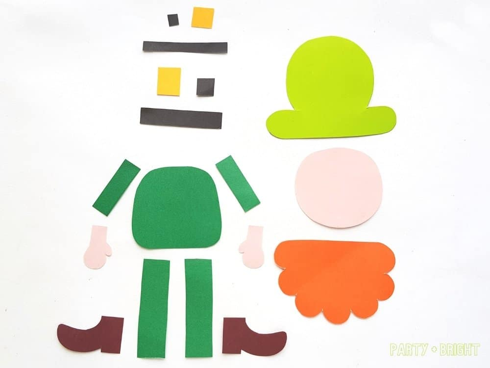 pieces cut from template of leprechaun in colored paper
