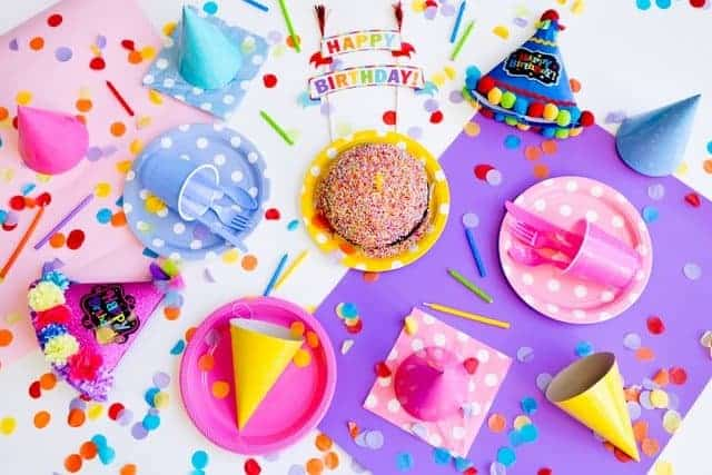 colorful party decorations in a flat lay