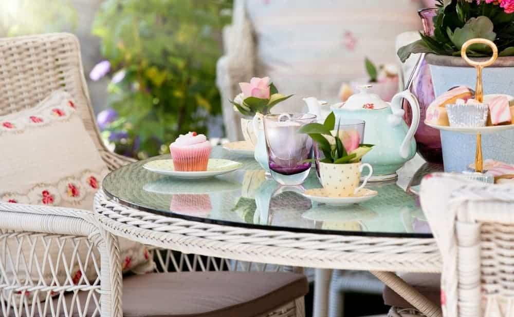 pastel tea set on an outdoor table
