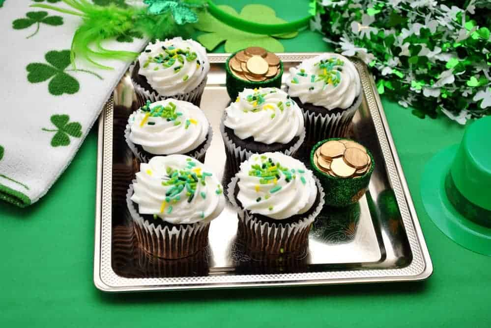 chocolate st. patricks day cupcakes surrounded by festive holiday decorations