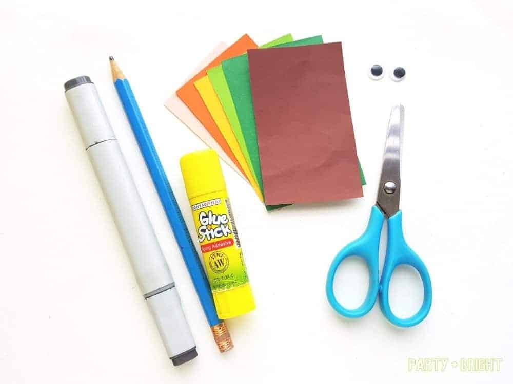 supplies for a paper leprechaun craft spread out on white background