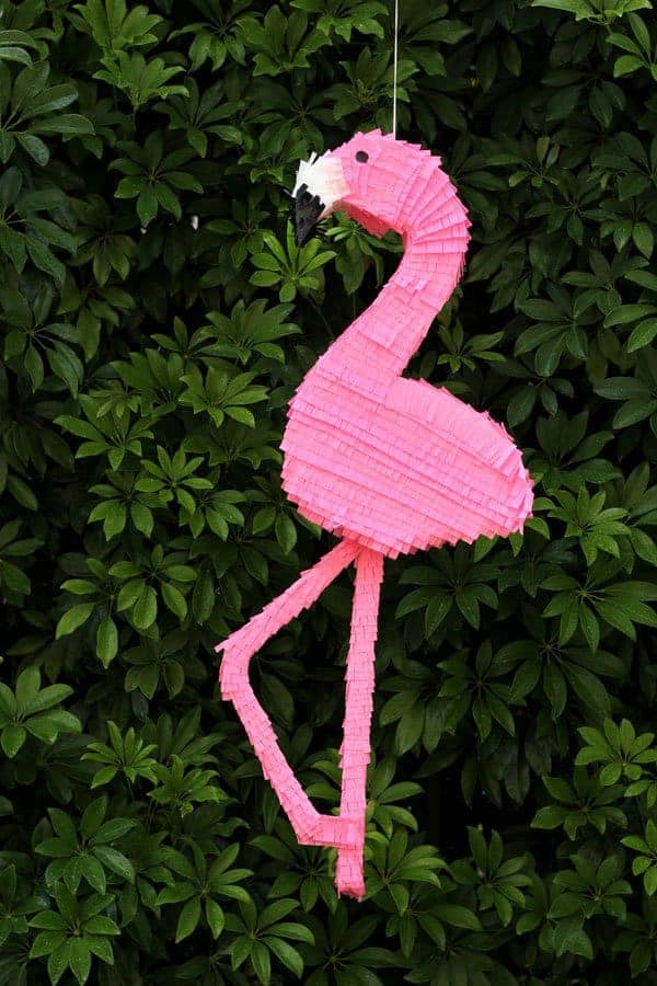 pink diy flamingo pinata against tree background