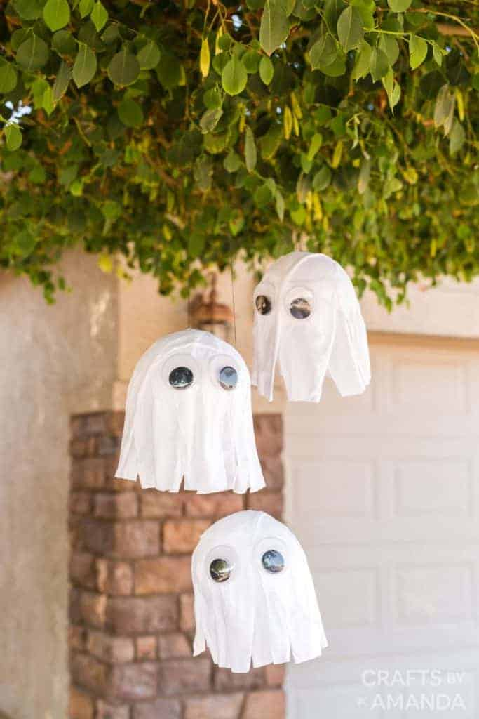 DIY balloon ghosts hanging from a tree