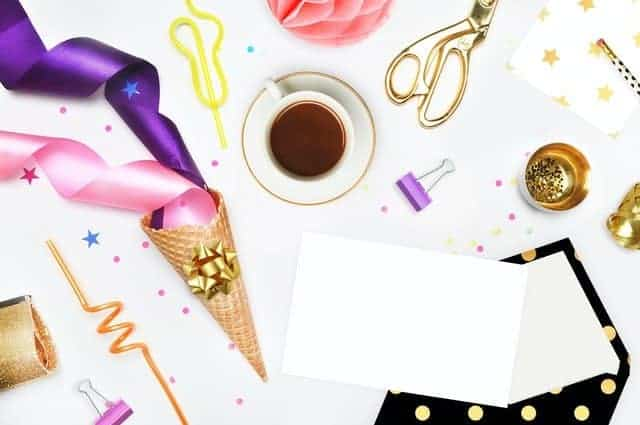 flat lay image with party decorations and coffee shot from above
