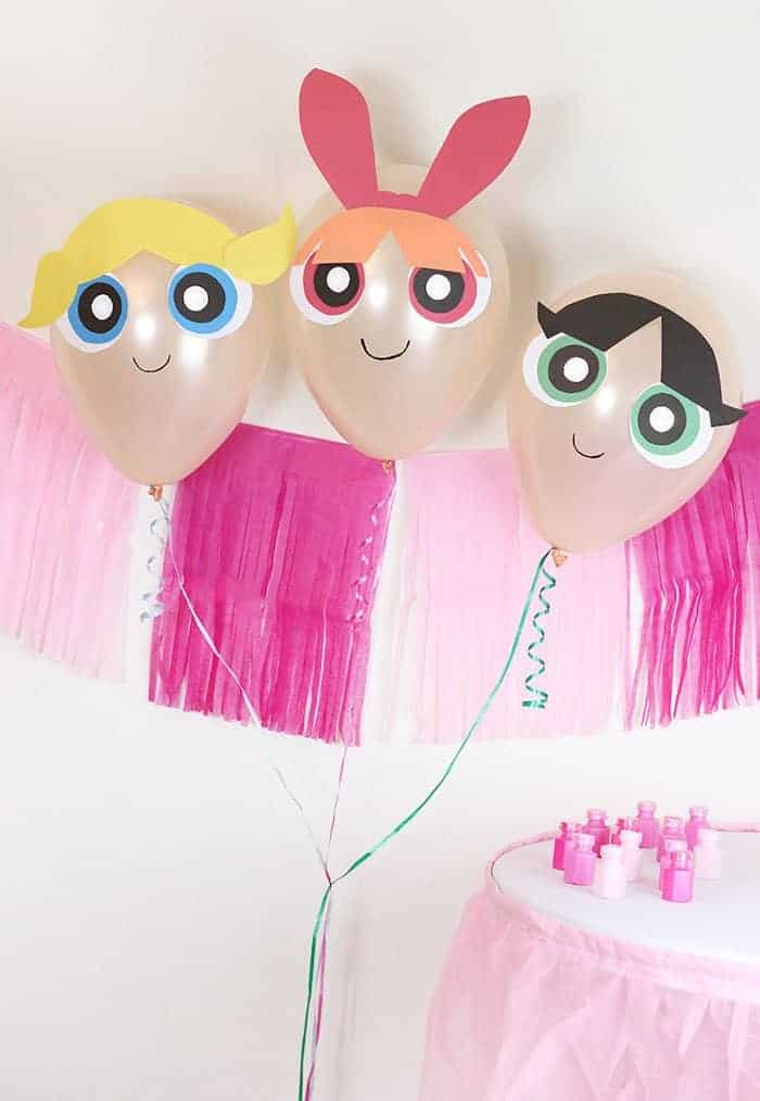 DIY powder puff girls balloons inflated at a party