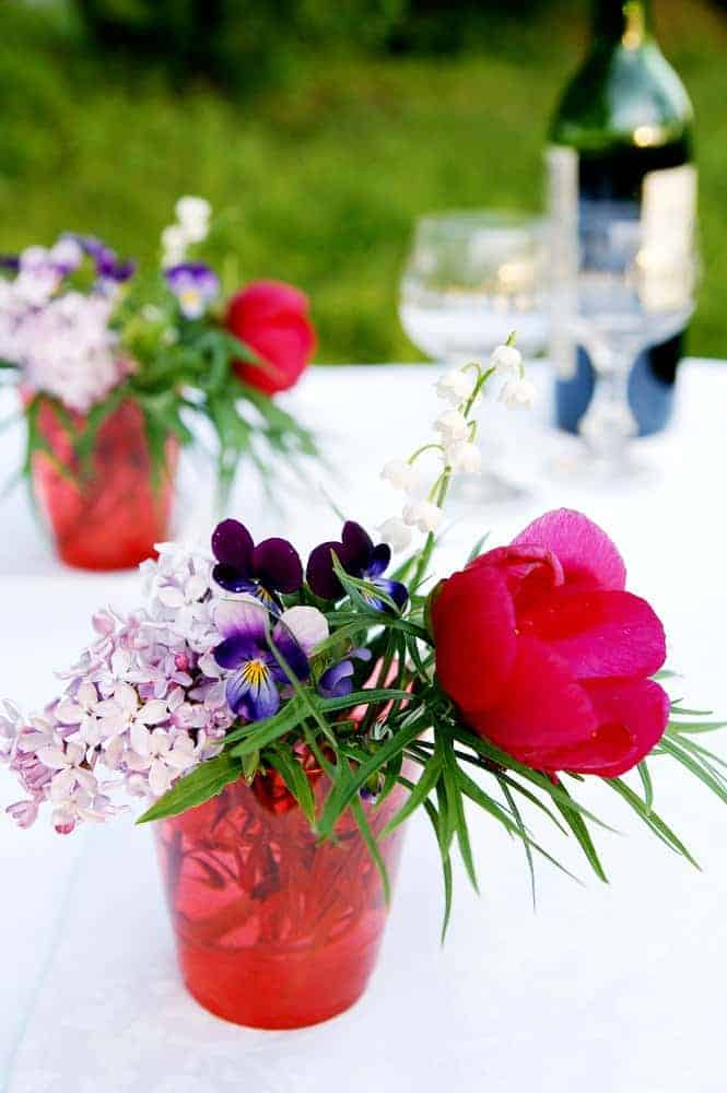 easy eco friendly party decoration of cut flowers in simple vases