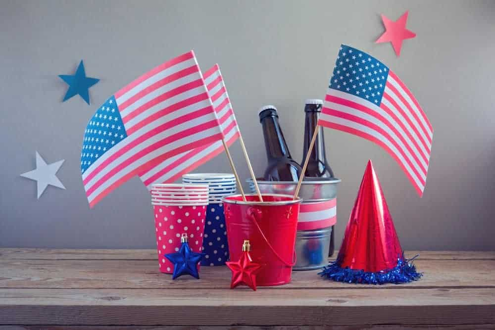 4th of july centerpiece with small metal buckets and american flags with patriotic cups