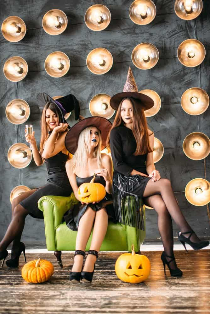 3 teens dressed as witches at a teen halloween party