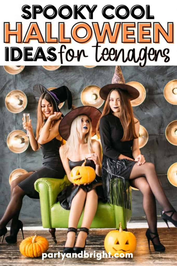 three teenage girls poing for an instagram pictures with witches hats in front of a lit background with text spooky cool halloween ideas for teens